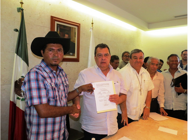 Activists with Governor Aguirre in Mexico as he signs CECOP's proposal on Aug 16, 2012. Flickr photo by Felipe de Jesús Salinas Galván