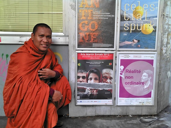 The Venerable Luon Sovath in Geneva, next to a poster for the Martin Ennals Award. October 2012. Photo courtesy of Ryan Schlief