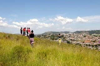 Training participants look over the proposed path of Tronco Avenue in Porto Alegre, Brazil.
