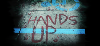 Graffiti at QuikTrip parking lot in Ferguson