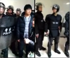 Cell phone video footage showing riot police arriving at the Xingang Center Hospital in Xinyu, Jiangxi province, to take Hu Tengping's body away on March 17, 2013.